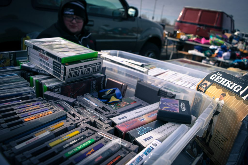 Boxes of game discs and cartridges for sale.